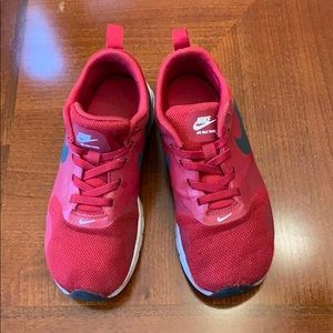 Nike Red Tennis shoes.